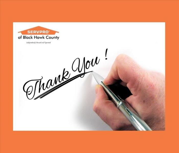 "Pen in Hand on white surface with the words, ""Thank you!"""
