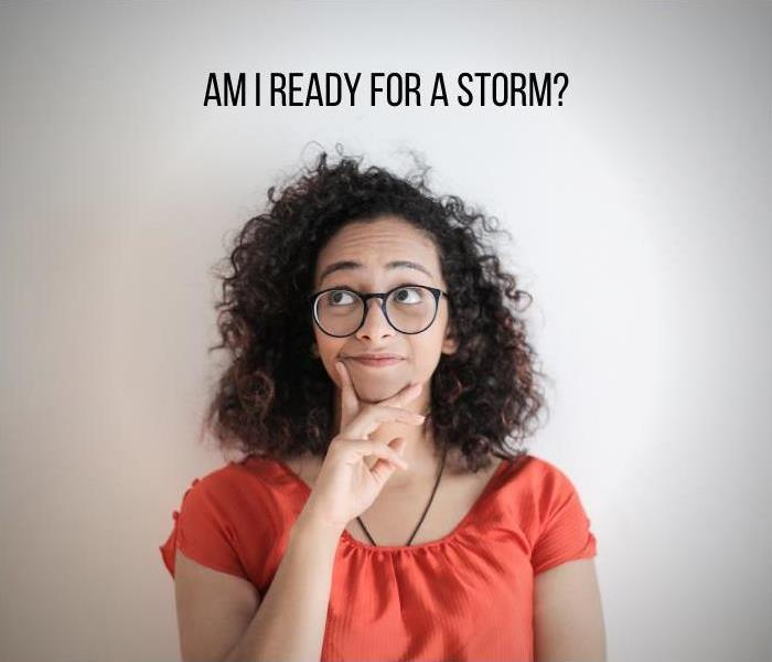 "A tan woman with curly hair and glasses looks up in a pensive manner? Text that reads ""Am I ready for a storm?"" is on the top"